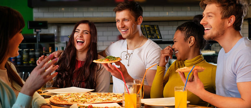 A group eating pizza