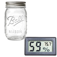 cannabis flowers curing jar and hygrometer